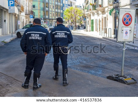 "two officers ""Municipal Police"" officers monitor the under progress of work regular city street - stock photo"