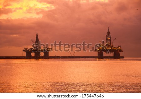 Two oil platforms at sunrise in Las Palmas de Gran Canaria, Canary Islands, Spain. - stock photo