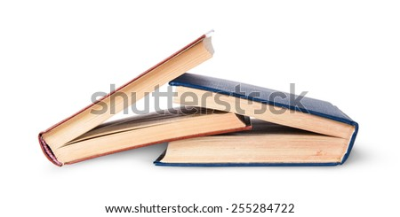 Two old books imbedded in one another isolated on white background - stock photo