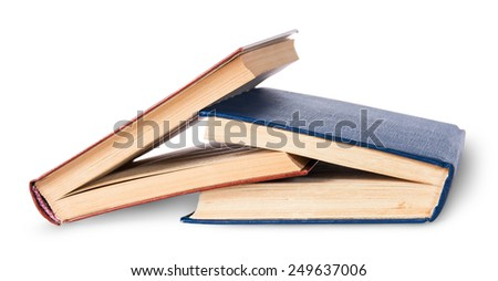 Two old books imbedded in one another rotated isolated on white background - stock photo