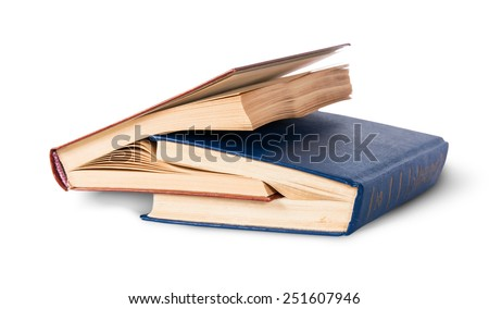 Two old books nested rotated isolated on white background - stock photo