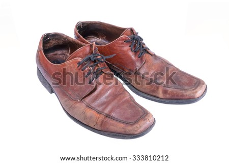 two old boots of brown color on a white background - stock photo