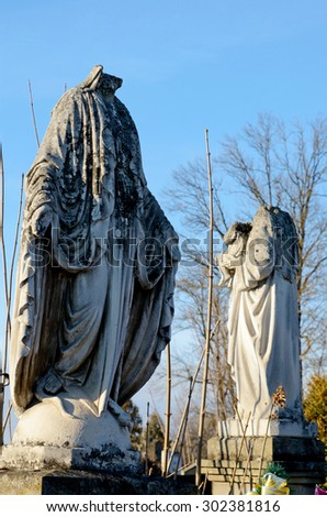 Two old destroyed stone statues namohylah in the old cemetery in Ukraine - stock photo