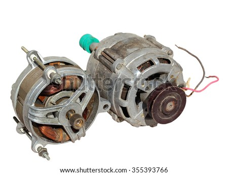 Two old electric motors isolated on white background. - stock photo