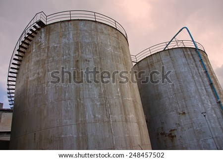 Two old industrial towers used for storage - stock photo