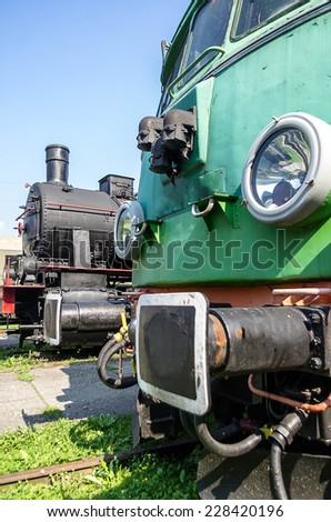 Two old locomotives, electric and steam - stock photo