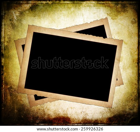 Two old paper frames with frayed edges on dirty background