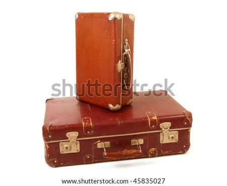 Two old suitcases for travel on white background