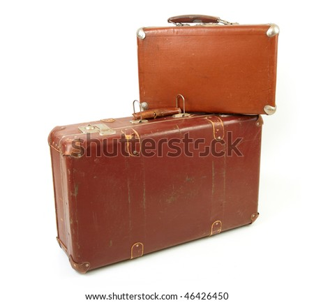 Two old suitcases for travel on white background - stock photo