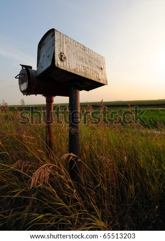 Two old tin mailboxes in the Alberta, Canada prairies or grasslands - stock photo