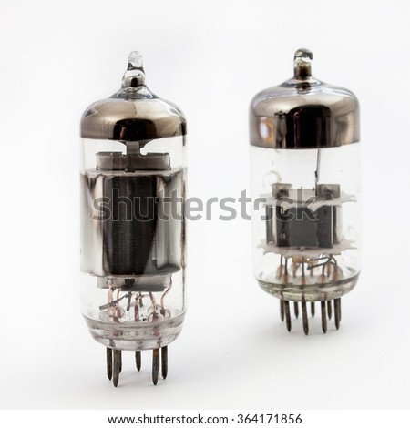 Two old vacuum tubes isolated on the white background