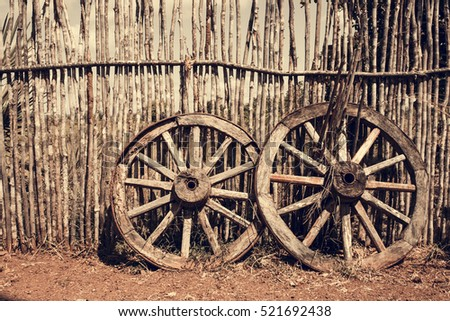 Two Old Wagon Wheels Near Wooden Stock Photo (Royalty Free) 521692438    Shutterstock
