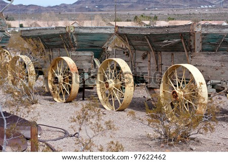 two old wild west wagons in a row with metak wheels - stock photo