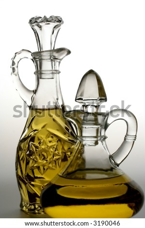 Two olive oil bottles on white background