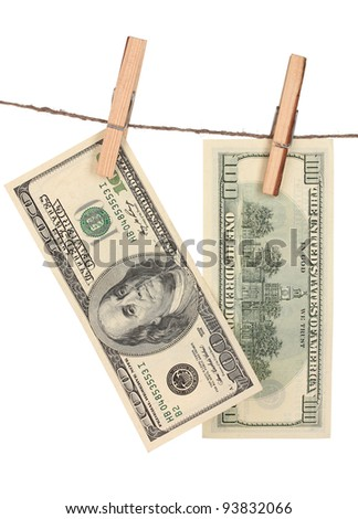 Two one hundred dollar bills is hanging on a rope with wooden clothespin isolated on white - stock photo