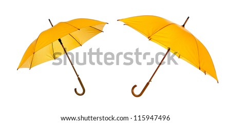 Two opened yellow umbrellas isolated against white background - stock photo