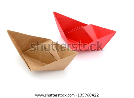 two origami boats on sailing playground
