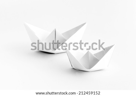 Two Origami White Paper Boat on White Background