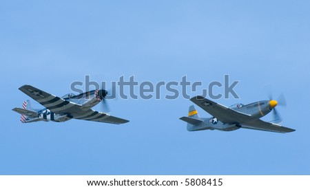 Two P-51 Mustangs flying in formation - stock photo