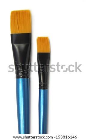 two paint brushes isolated on white background - stock photo