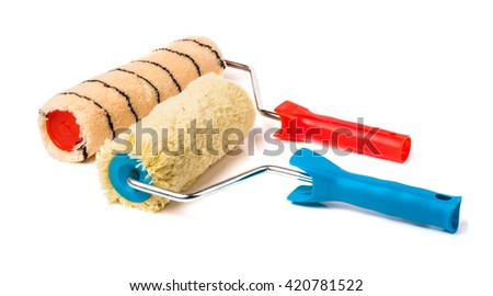 Two paint rollers isolated on white background - stock photo