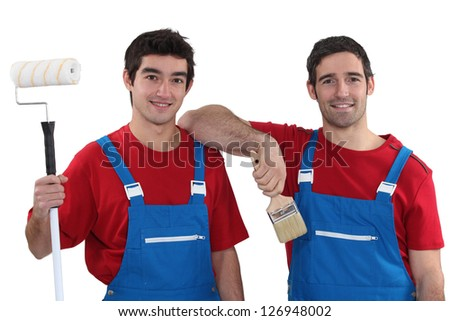 Two painters wearing matching outfits - stock photo