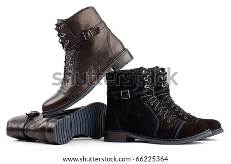 Two pairs of black laced boots isolated on a white background - stock photo