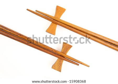 Two Pairs of Chopsticks Isolated on a White.