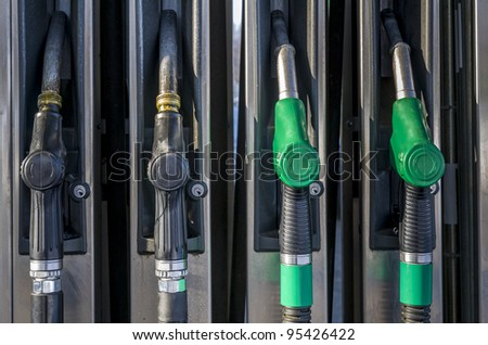 Two pairs of gasoline pumps at petrol station - stock photo