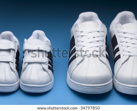 Two pairs of sports shoes, close-up - stock photo