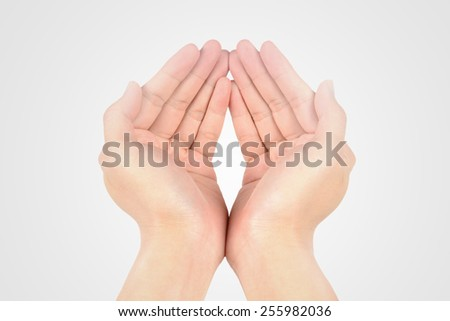 Two palms open up as a gesture of peace and giving thanks,  - stock photo