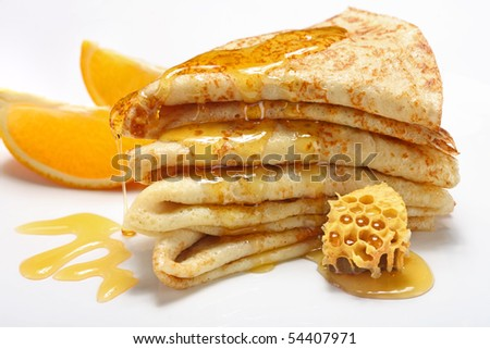 Two Pancakes with honey on white background - stock photo
