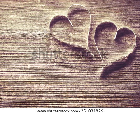 Two paper hearts on wooden background with copyspace - stock photo