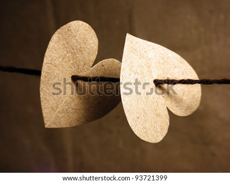 Two paper hearts tied on wire. Love concept. - stock photo