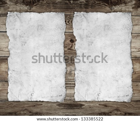 two papers on the wood background - stock photo