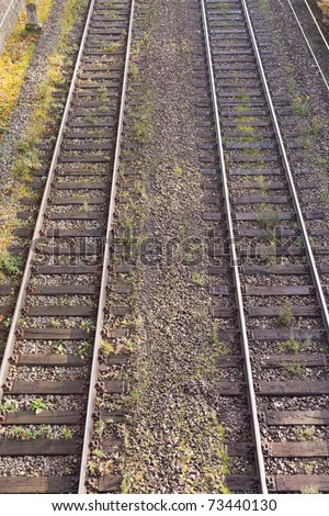 Two parallel railway tracks in embankment of gravel. - stock photo