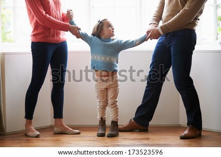 Two Parents Fighting Over Child In Divorce Concept - stock photo