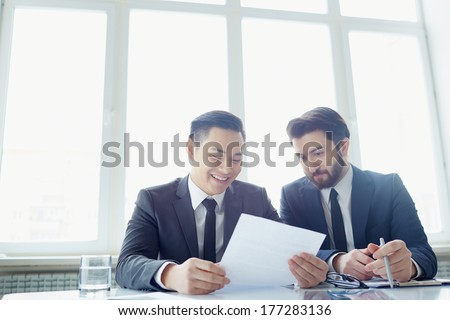 Two partners reading contract - stock photo
