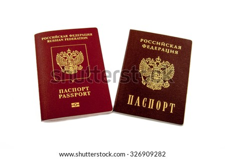 Two passports - internal Russian passports and the passport of the Russian Federation isolated on white background  - stock photo