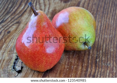 Two pears on a old wooden table, closeup