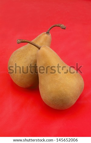 Two Pears on Red Background - stock photo