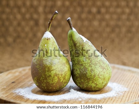 Two pears with flour. Flour tries to imitate snow