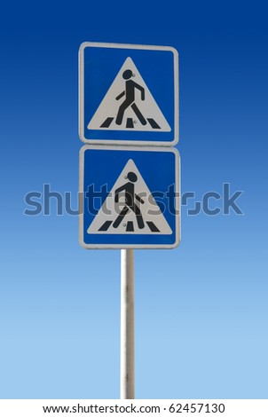 Two pedestrian Sign on a blue background - stock photo