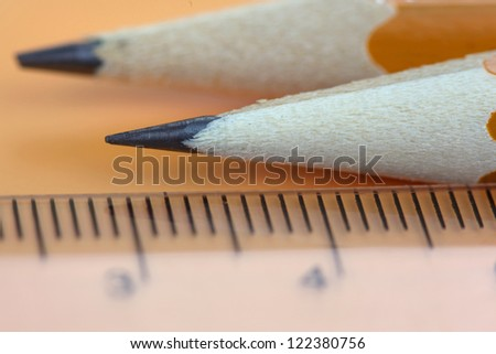 Two pencils and a scale close up shot - stock photo