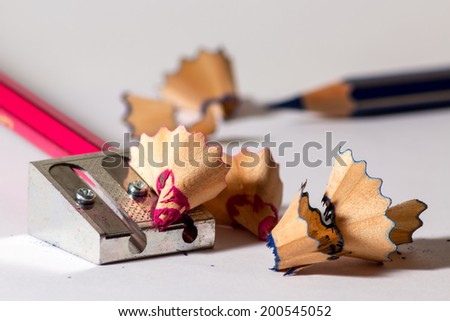 Two pencils with an iron sharpener - stock photo