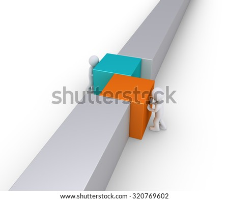 Two people are pushing different square blocks in order for the wall to be complete - stock photo