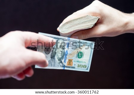 Two people exchanging money