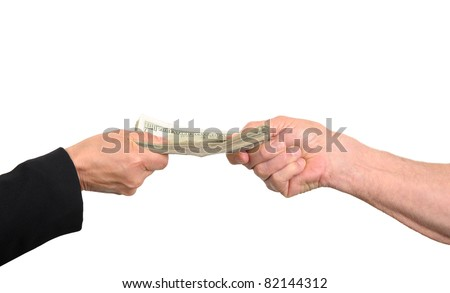 Two people fight for money to pay of loans and other debts. - stock photo