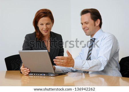 Two People Having A Business Meeting