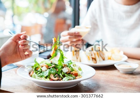 two people having a business meeting over lunch  - stock photo